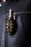 De granaat van de hand in jasje`s zak. Royalty-vrije Stock Foto's