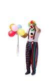 De grappige die clown met ballons op witte achtergrond wordt geïsoleerd Royalty-vrije Stock Foto's