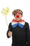 De grappige die clown met bloemen op wit wordt geïsoleerd Stock Foto