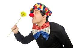 De grappige die clown met bloemen op wit wordt geïsoleerd Stock Fotografie
