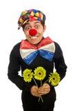 De grappige die clown met bloemen op wit wordt geïsoleerd Stock Afbeeldingen