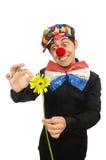 De grappige die clown met bloemen op wit wordt geïsoleerd Stock Foto's