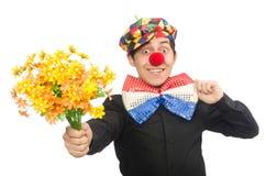 De grappige die clown met bloemen op wit wordt geïsoleerd Stock Afbeelding