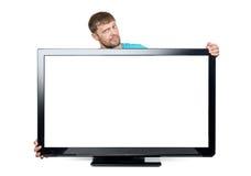 De grappige gebaarde mens verpakte zijn wapens rond de brede Televisie op witte achtergrond Het dossier bevat een weg aan isolati royalty-vrije stock foto's