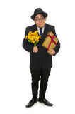 De grappige man met bloemen en giftbox Stock Foto's