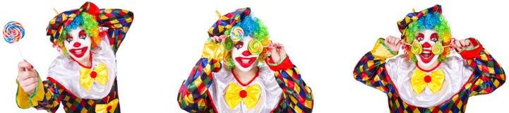 De grappige mannelijke clown met lolly stock afbeeldingen