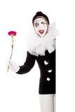 De grappige vrouwelijke clown met bloem is gelukkig Royalty-vrije Stock Afbeelding