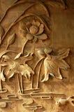 De gravures van de baksteen van lotusbloembloemen Stock Foto's