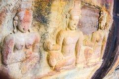 De gravures van de Bashulp op klippenmuur Stock Foto