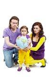 De greep bal-aarde van de vader, van de moeder en van de dochter Stock Foto