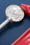 De Greep en het muntstuk van de bankschroef Stock Afbeelding