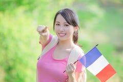 De greep Franse vlag van het universiteitsmeisje Royalty-vrije Stock Afbeelding