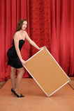 De greep lege raad van het meisje Stock Foto's