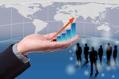 De greep van de zakenman een de groeigrafiek Royalty-vrije Stock Afbeelding