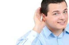 De greephand van de mens dichtbij oor Royalty-vrije Stock Foto's
