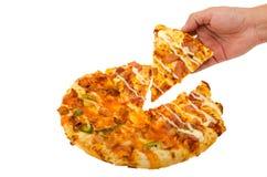 de greeppizza van de mensenhand Stock Afbeelding