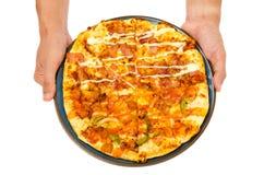 de greeppizza van de mensenhand Stock Foto's