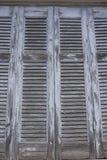 De Griekse blinden van de vensterluifel met schilverf Stock Afbeelding