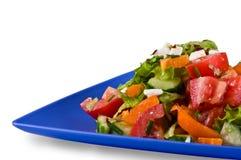 De Griekse salade, donkerblauwe plaat Stock Afbeelding