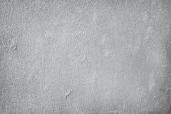 De grijze achtergrond van de de muurtextuur van het kleurencement concrete, detail van ruwe gipspleister en oude grungesamenvatti stock fotografie