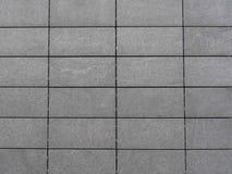 De grijze Achtergrond van Tegels Stock Afbeeldingen