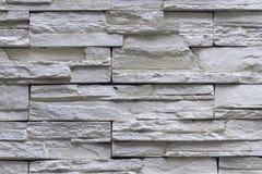 De grijze decoratieve bakstenen muur van de granietsteen Stock Fotografie