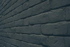 de grijze donkere achtergrond van de bakstenen muurtextuur Stock Fotografie
