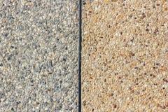 de grijze en gele vloer van het kiezelsteengrint Royalty-vrije Stock Foto