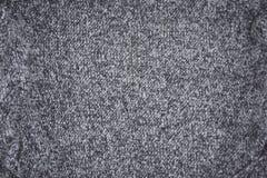 De grijze gebreide achtergrond van het textuurpatroon royalty-vrije stock afbeeldingen