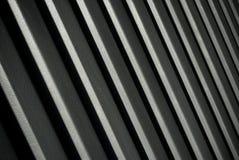 De grijze golfachtergrond van het metaalblad stock foto