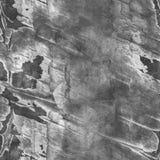 De grijze naadloze gebarsten achtergrond van de steenmuur Stock Foto's