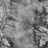 De grijze naadloze gebarsten achtergrond van de steenmuur Royalty-vrije Stock Afbeeldingen