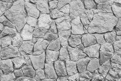 De grijze textuur van de steenmuur Oude natuurlijke keiweg Stock Afbeelding