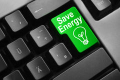 De grijze toetsenbord groene knoop bespaart energie Stock Foto