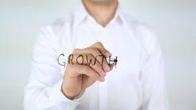De groei, Zakenman Writing op Glas royalty-vrije stock foto