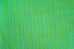 De groene achtergrond van de stoffentextuur Royalty-vrije Stock Afbeeldingen