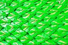 De groene achtergrond van draakschalen of Serpentgipspleister stock foto