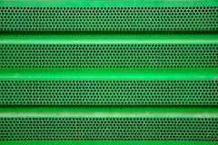 De groene achtergrond van de metaalgrill, ijzerdeklaag stock afbeelding