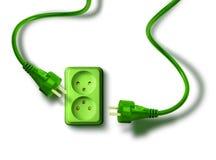 De groene contactdoos van de het conceptenmuur van de energiebehoefte Stock Foto