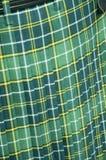De groene Kilt van het Geruite Schotse wollen stof Stock Foto's