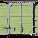 De groene schuifdeur van de houtmunt royalty-vrije stock fotografie
