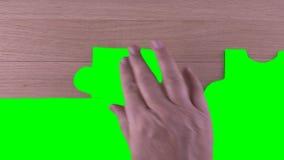 De groene stukken van het het schermraadsel stock video