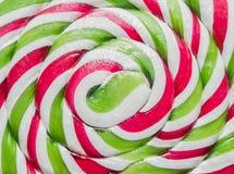 De groene, witte en rode stok van suikergoedkerstmis, lolly Stock Foto