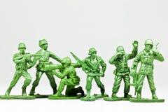 De groep stuk speelgoed militairen stock afbeeldingen