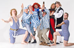 De groep van het theater in kostuum stock foto's
