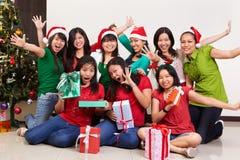 De groep van Kerstmis die van Aziatische mensen is ontsproten Royalty-vrije Stock Afbeeldingen