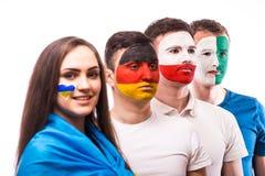 De groep voetbalventilators steunt hun nationaal team: De Oekraïne, Duitsland, Polen, Noord-Ierland Royalty-vrije Stock Afbeelding