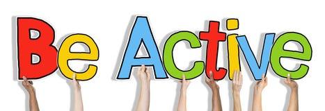 De groep Word van de Handenholding Actief is Stock Foto