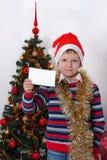 De groetkaart van de jongensholding christmastime Royalty-vrije Stock Foto's