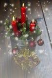 De groetkaart van Kerstmis met kaarsen Royalty-vrije Stock Fotografie